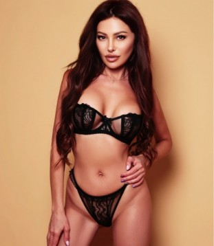 A Photo Of Escort Nadine In A Sexy Black Lingerie Set