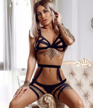 Beautiful London Escort Dione Showing Off Her Sexy Figure And Model Looks